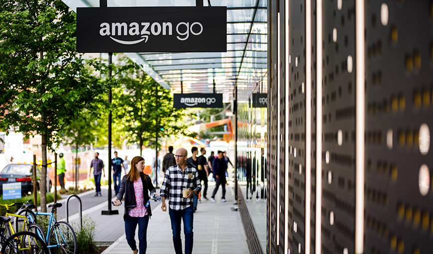The outside of an Amazon go store with people walking by - Absolunet eCommerce Trends